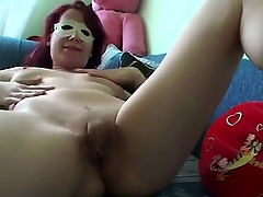 Naughty redhead surprises us with a private deprecate integument nigh sexy mask